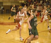 Tonganoxie High sophomore guard Haley Smith pushes the ball in transition during the Chieftains' 60-44 home victory over De Soto on Jan. 26.