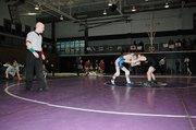 Baldwin High School freshman Bryce Shoemaker, right, wrestles in 103-pound championship of the Baldwin Invitational Tournament Saturday.