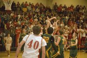Tonganoxie High senior forward Keaton Schaffer (center) releases a runner in traffic against Basehor-Linwood on Tuesday. The Chieftains lost to their Kaw Valley League rival, 61-52.