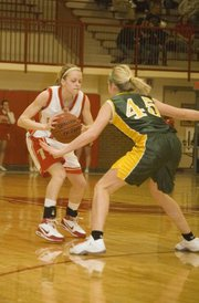 Tonganoxie High senior Lauren Hall throws a ball fake at a Basehor-Linwood defender on Tuesday night. The Chieftains fell at home, 74-53.