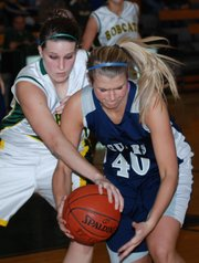 Mill Valley's Nicole Garretson, right, and Basehor-Linwood's Megan Bergstrom battle for a loose ball during Basehor's 46-37 victory Friday at BLHS.