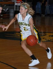 Basehor-Linwood guard Shelby Equels pushes the ball up the court during the Bobcats' 46-37 victory against Mill Valley on Friday.