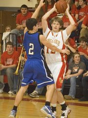 Keith Slater scans the floor for an opening in the fourth quarter of Tonganoxie High's 53-22 home victory over Perry-Lecompton on Friday. Slater was one of five THS subs to play in the blowout.