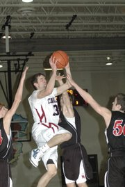 Justin Ballock drives in for a layup during the first half against Metro Academy Friday at Eudora. Ballock scored 20 points in Eudora's 64-41 victory.