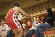 """Tonganoxie High sophomore wrestler Jonas Myers high-fives Shane Lewis, a Tonganoxie Elementary School second-grader, after winning a match on Feb. 4. The two became friends through the THS """"Leadership in Sports"""" class, which sends its students to the elementary school weekly."""