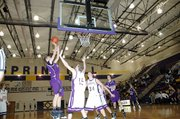 Baldwin High School freshman Caleb Gaylord scores two of his eight points Friday night at Spring Hill.