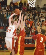 Dane Erickson powers over Atchison's defense in Tonganoxie's 74-48 victory Tuesday.
