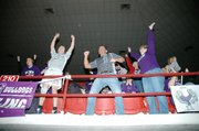 Baldwin High School fans jump for joy after BHS junior Colby Soden beat Eudora's Tim Wright with an amazing 11-point swing in the third period. Pictured here is the Hanson family. They are, from left, Josh (BHS senior), John and Lee Hanson.