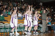 Members of the Baldwin High School girls' basketball team celebrate their win Thursday night over Sumner Academy.