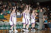 Members of the Baldwin High School girls' basketball team celebrate their win Thursday night over Sumner Academy.