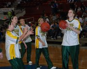 The Basehor-Linwood girls shoot around during halftime of the Cheney-Circle game at the Class 4A state tournament. BLHS plays defending state champions Concordia tonight.