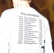 Caleb Seaton, Bonner Springs junior and nephew of Basehor-Linwood wrestling coach Ed Seaton, wears the BSHS wrestling team's T-shirt at a tournament this season. The T-shirt includes the names of all Bonner Springs wrestling state champions, including two-time champ Ed Seaton.