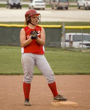 Tonganoxie senior Lindsey Fatherley claps at second base after driving in a go-ahead run in the bottom of the sixth inning of the Chieftains' first game against Jeff West Thursday. Although THS lost, 6-2, Fatherley came through with another clutch hit (a two-run single in the seventh) of the Chieftains' 15-14 extra-inning victory in the second contest.