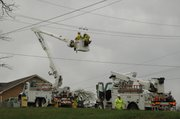 Crews work on powers lines at Kansas Highway 7 and 130th Street in Bonner Springs. The area near this location and up to K-7 and Kansas Avenue were without power most of the morning and into the afternoon.