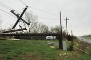 A power line pole along Kansas Highway 7 near Kansas Avenue was snapped in half Friday following a severe storm. As a result, power in the area was out for most of the morning and into the afternoon.