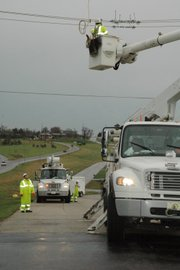 Crews worked Friday afternoon on power lines at Kansas Highway 7 and 130th Street following a storm with high winds.