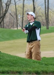 Basehor-Linwood senior Bobby Courtney chips out of a sand trap during the Mill Valley Invitational.