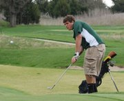 Basehor-Linwood's Nick Rhodes chips onto the green during the Mill Valley Invitational.