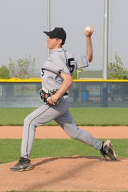 Mark Biesma fires a pitch during the Jaguars' 7-2 victory Monday against Bishop Miege. Biesma threw a two-hitter in the victory.