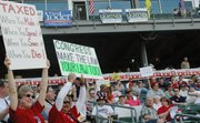 Thousands of people attended a tea party rally Thursday, April 15 at CommunityAmerica ballpark in Wyandotte County.
