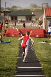 Jake Willis prepares to take one of his early pole vault attempts Thursday afternoon before he won the event with a mark of 12-6. The Tonganoxie boys finished second at the Tonganoxie Invitational.