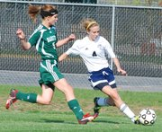 Mill Valley's Kelsey Wakefield prepares to cross a pass to a teammate during the first half against Barstow. Mill Valley won the game, 5-0.