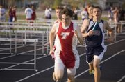 Matt Titterington hits another gear for the final 50 yards of his leg of the 4x800 relay race Thursday at the Tonganoxie Invitational. Tonganoxie High's boys finished fourth in that race and second in team points.