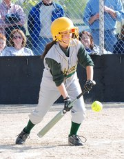 Basehor-Linwood senior Caylee Smith lays down a successful bunt during the Bobcats' doubleheader sweep of rival Lansing.