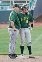Basehor-Linwood baseball coach Dave Svoboda chats with Dylan Belt after Belt's run-scoring triple knocked the Holton starting pitcher out of the game. BLHS won the game, 10-0.