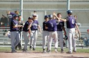 Baldwin High School sophomore Hunter Burkhart (No. 1) is greeted by teammates at home plate after his first inning home run Tuesday. Burkhart hit another homer two innings later.