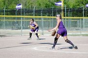 Baldwin High School sophomore Hayley Schwartz pitches Tuesday while junior Karlee Beach covers third base. The Bulldogs were swept by Eudora.