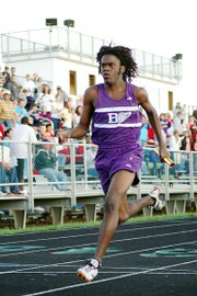 Baldwin High School sophomore Dayshawn Berndt crosses the finish line as the anchor of the 400-meter relay team. Berndt also helped the Bulldogs win the 1,600-meter relay.