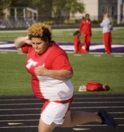 Domino Grizzle, a Tonganoxie junior, won both the shot put and discus throwing events on Friday at the Piper Invitational.