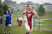Tonganoxie High senior Bret Koch runs in the 4x800 relay on Wednesday at the Kaw Valley League meet at Mill Valley. The Chieftains finished third in the event.