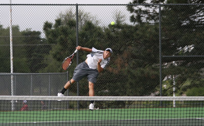 De Soto High School senior Andrew Konetzni serves during his semifinal loss at the 4A State Tennis Tournament in Pratt.