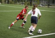 THS defender Shyanne Gergick tries to stay in front of a St. James player in Tonganoxie's 8-0 loss on Monday.