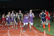 Baldwin High School sophomore Dayshawn Berndt, second from right, takes the baton from junior Josh Hoffman before beginning the final leg of the 1,600-meter relay. The Bulldogs won the race, which bumped them into second place in the team standings.