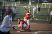 Tonganoxie High third baseman Katelyn Wolken firest a throw to first as pitcher Angela Jacobs ducks out of the way. The Chieftains defeated Atchison, 3-1, before falling to Perry-Lecompton, 3-0, in a regional semifinal Tuesday.