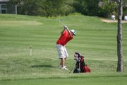 Mitch DeHoff takes a shot out of the rough on Monday at the Class 4A state golf tournament in Hesston. DeHoff finished with an 86, helping Tonganoxie High finish fourth at state.