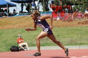Baldwin High School senior JaBryanna Wellington won her heat of the 400-meter dash Friday. She will race in the finals Saturday. She also helped the 400- and 1,600-meter relays qualify for the finals.