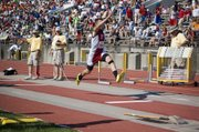 Dylan Scates shows pronounced form on one of his triple-jump attempts Friday morning at Cessna Stadium. The Tonganoxie High junior finished sixth in the event to win a state medal.