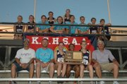 The Baldwin High School girls&#39; track and field team won the Class 4A state championship Saturday night in Wichita. It was the first-ever state title in track for BHS girls&#39; coach Ted Zuzzio, seated far right.