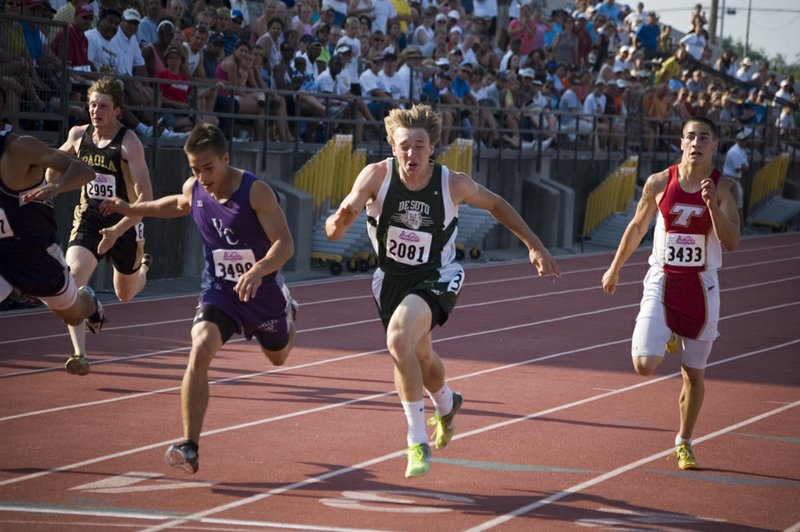 De Soto High junior sprinter Jordan Riffel leans forward just enough to win a state championship in the 200-meter dash Saturday evening at Cessna Stadium. Riffel beat out runner-up Joe Fisher of Valley Center by two hundredths of a second, giving him a Class 4A championship time of 21.96.