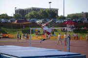 Dylan Jacobs hurls his body upward for a high jump attempt Friday morning at the state track meet. A sophomore, Jacobs tied for sixth in the event in his first state appearance.