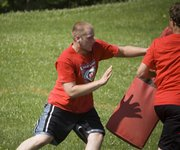 Dylan Fosdick goes through lineman drills at Tonganoxie High football camp on June 2.