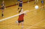 Danielle Miller spikes the ball over the net on Wednesday at THS volleyball camp.