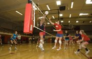 Haley Smith blocks a play made by Jo Kissinger on Thursday afternoon at Tonganoxie High volleyball camp.