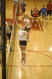 Holley Thompson sends the ball down with a play above the net on Wednesday at THS volleyball camp.