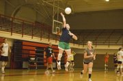 Megan Hummelgaard gets up in the air to send a shot back across the net on Wednesday at Tonganoxie volleyball camp.