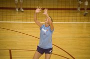 Sagan Scates prepares herself to set the ball for a teammate on Wednesday at Tonganoxie volleyball camp.